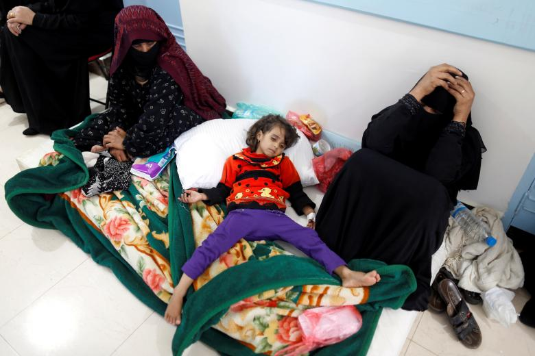 Girl infected with cholera lies on the ground at a hospital in Sanaa