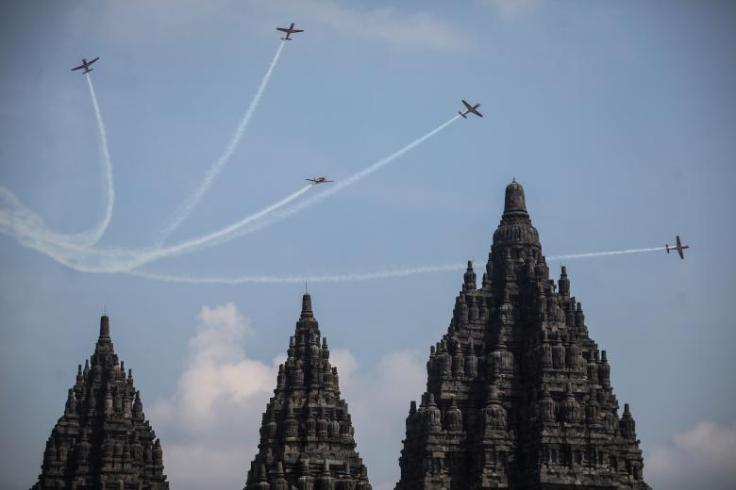Planes from the Indonesian Air Force's Jupiter Aerobatic Team fly near the Prambanan Hindu temple during the Yogyakarta International Air Show in Central Java