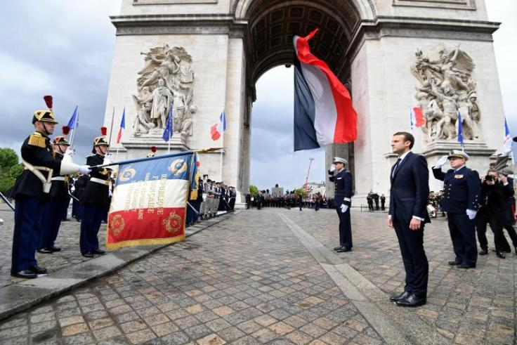 French President Emmanuel Macron attends a ceremony near the Tomb of the Unknown Soldier at the Arc de Triomphe in Paris